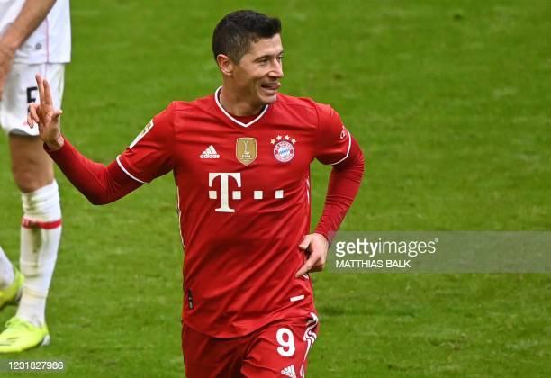 Bayern Munich's Polish forward Robert Lewandowski celebrates scoring his team's fourth goal during the German first division Bundesliga football...