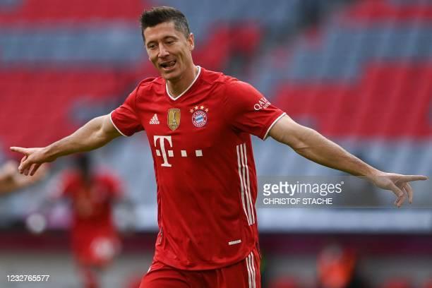 Bayern Munich's Polish forward Robert Lewandowski celebrates scoring the opening goal with his teammates during the German first division Bundesliga...