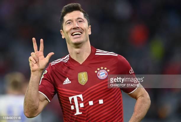Bayern Munich's Polish forward Robert Lewandowski celebrates scoring the 5-0 and his hattrick during the German first division Bundesliga football...