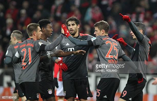 Bayern Munich's Polish forward Robert Lewandowski celebrates scoring with his teammates during the German first division Bundesliga football match...