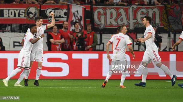 Bayern Munich's Polish forward Robert Lewandowski celebrates scoring with Bayern Munich's Austrian defender David Alaba Bayern Munich's French...