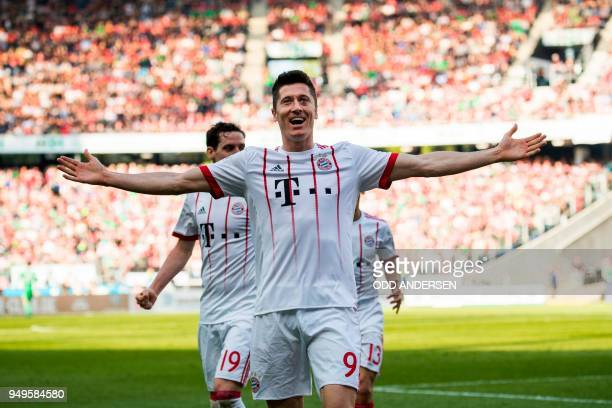 Bayern Munich's Polish forward Robert Lewandowski celebrates scoring his teams second goal during the German first division Bundesliga football match...