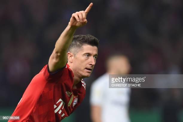 Bayern Munich's Polish forward Robert Lewandowski celebrates scoring during the German Cup DFB Pokal final football match FC Bayern Munich vs...