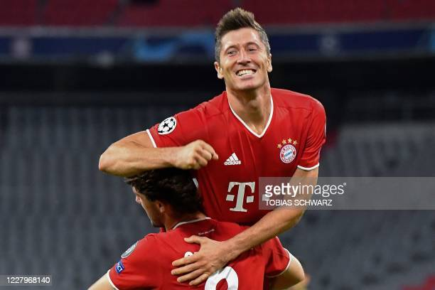 TOPSHOT Bayern Munich's Polish forward Robert Lewandowski celebrates with his teammate Bayern Munich's Spanish defender Alvaro Odriozola after...