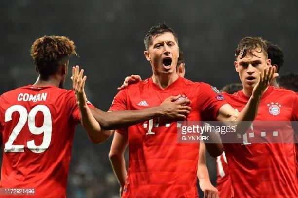 Bayern Munich's Polish forward Robert Lewandowski celebrates with teammates after scoring their second goal during the UEFA Champions League Group B...