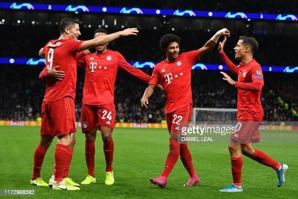 Bayern Munich's Polish forward Robert Lewandowski celebrates with teammates after scoring their sixth goal during the UEFA Champions League Group B...