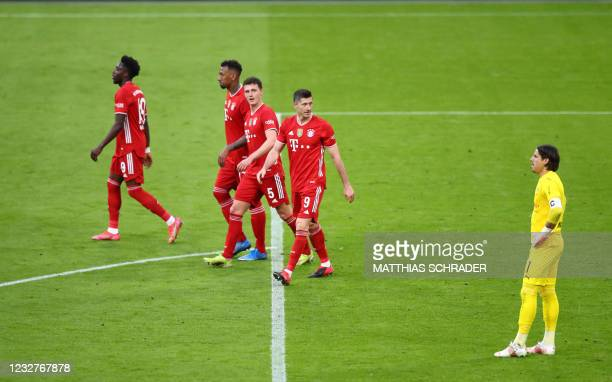 Bayern Munich's Polish forward Robert Lewandowski celebrates with teammates after scoring the 5-0 against Moenchengladbach's Swiss goalkeeper Yann...