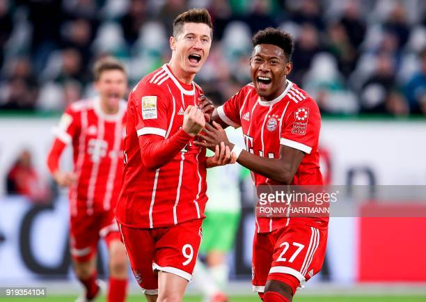 Bayern Munich's Polish forward Robert Lewandowski celebrates with Bayern Munich's Austrian midfielder David Alaba after scoring his team's second...