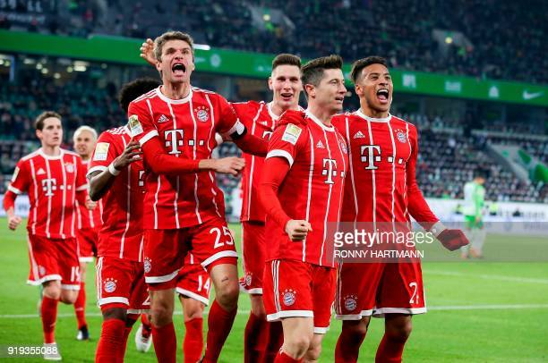 Bayern Munich's Polish forward Robert Lewandowski celebrates with teammates Bayern Munich's Austrian midfielder David Alaba and Bayern Munich's...