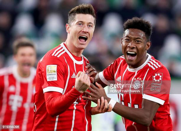 Bayern Munich's Polish forward Robert Lewandowski celebrates with Bayern Munich's Austrian midfielder David Alaba after scoring his team's second...