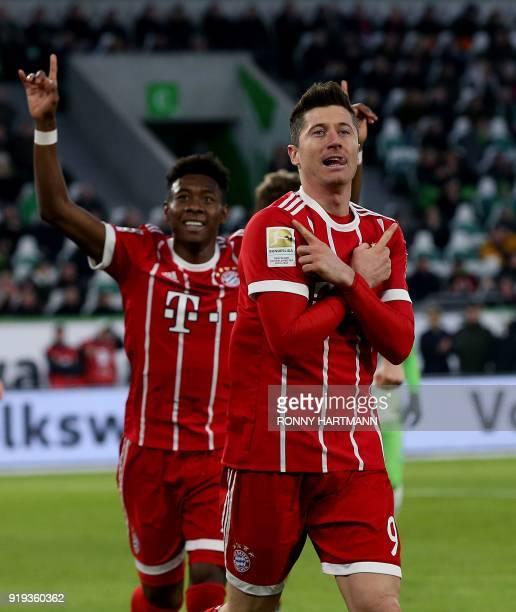 Bayern Munich's Polish forward Robert Lewandowski celebrates with Bayern Munich's Austrian defender David Alaba after scoring during the German first...