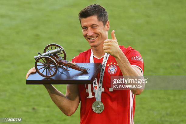 Bayern Munich's Polish forward Robert Lewandowski celebrates with the trophy for leading goal scorer after the German first division Bundesliga...