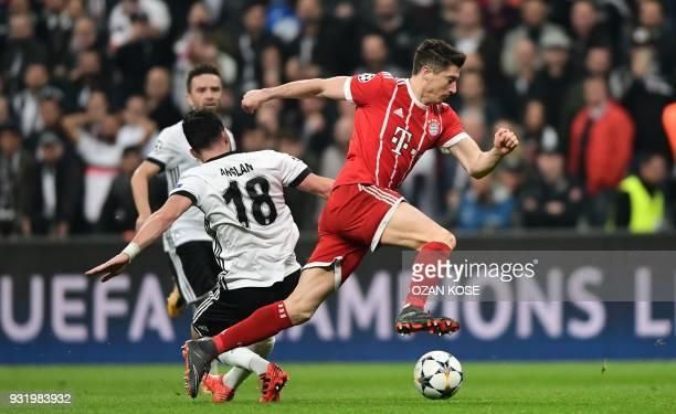 Bayern Munich's Polish forward Robert Lewandowski controls the ball as he passes Besiktas midfielder Tolgay Arslan during the second leg of the last...