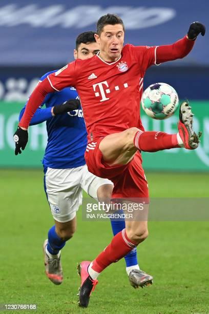 Bayern Munich's Polish forward Robert Lewandowski controls the ball during the German first division Bundesliga football match Schalke 04 v FC Bayern...