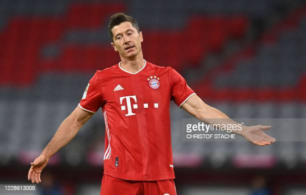 Bayern Munich's Polish forward Robert Lewandowski gestures during the German first division Bundesliga football match FC Bayern Munich v Schalke 04...