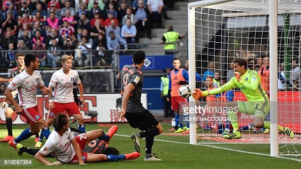 Bayern Munich's Polish forward Robert Lewandowski has an attemt on Hamburg's goalkeeper Rene Adler's goal during the German first division Bundesliga...
