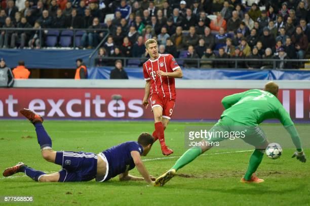 Bayern Munich's Polish forward Robert Lewandowski kicks to score a goal during the UEFA Champions League Group B football match between Anderlecht...
