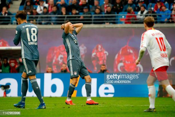 Bayern Munich's Polish forward Robert Lewandowski reacts after a missed free quick during the German first division Bundesliga football match RB...