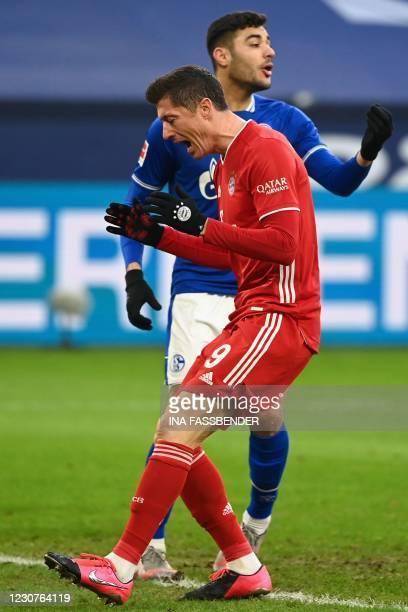 Bayern Munich's Polish forward Robert Lewandowski reacts after a missed chance during the German first division Bundesliga football match Schalke 04...