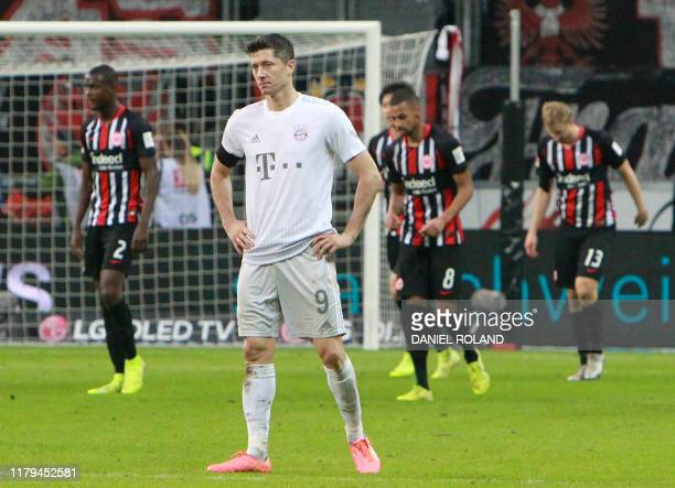 Bayern Munich's Polish forward Robert Lewandowski reacts after his team lost 51 in the German first division Bundesliga football match between...