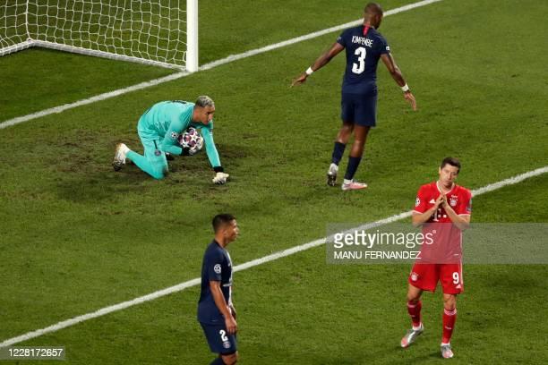 Bayern Munich's Polish forward Robert Lewandowski reacts after missing a goal opportunity against Paris Saint-Germain's Costa Rican goalkeeper Keylor...