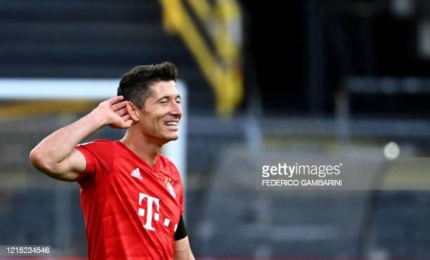 Bayern Munich's Polish forward Robert Lewandowski reacts after the German first division Bundesliga football match BVB Borussia Dortmund v FC Bayern...