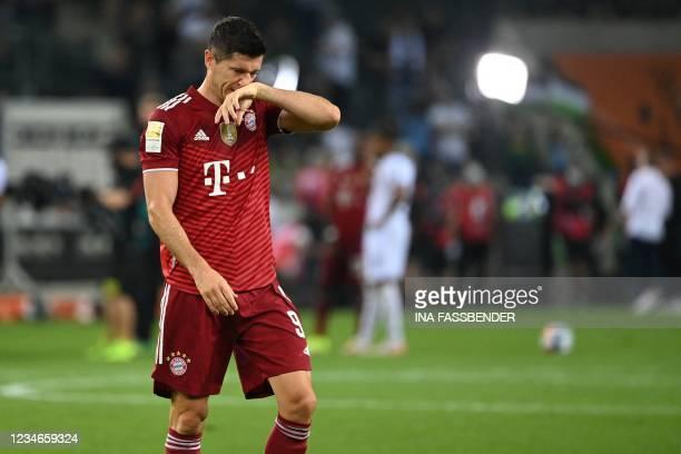 Bayern Munich's Polish forward Robert Lewandowski reacts after the German first division Bundesliga football match between Borussia Moenchengladbach...