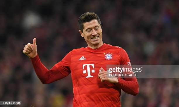Bayern Munich's Polish forward Robert Lewandowski reacts during the German first division Bundesliga football match FC Bayern Munich v RB Leipzig in...