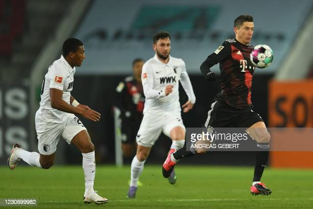 Bayern Munich's Polish forward Robert Lewandowski runs with the ball during the German first division football Bundesliga match FC Augsburg v FC...