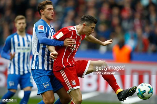 Bayern Munich's Polish forward Robert Lewandowski scores the 02 goal during the German first division Bundesliga football match between Hertha Berlin...