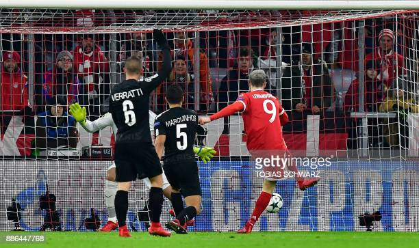 Bayern Munich's Polish forward Robert Lewandowski scores the 10 during the UEFA Champions League football match of Bayern Munich vs Paris...