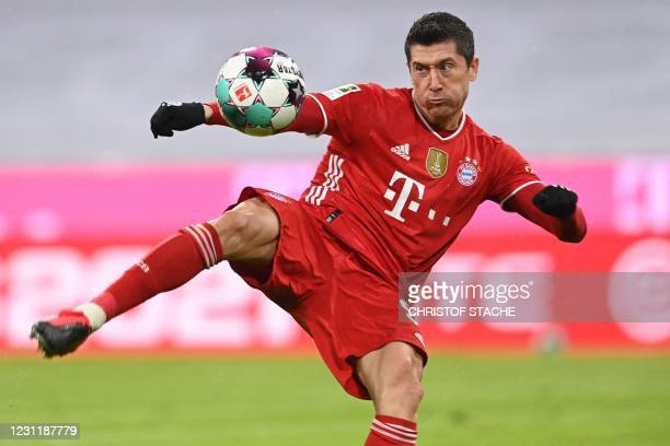 Bayern Munich's Polish forward Robert Lewandowski scores the 1-2 goal during the German first division Bundesliga football match FC Bayern Munich v...