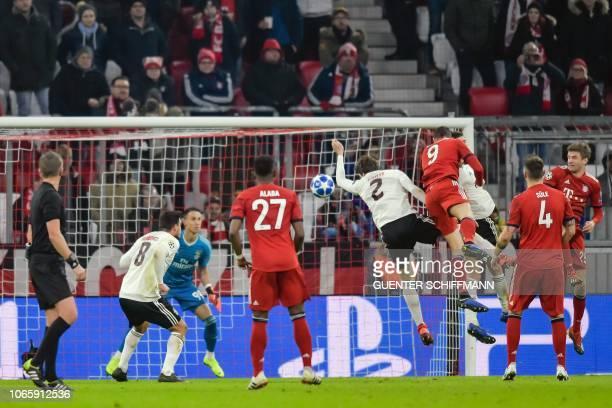 Bayern Munich's Polish forward Robert Lewandowski scores the 30 goal during the UEFA Champions League Group E football match Bayern Munich vs Benfica...