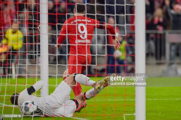 Bayern Munich's Polish forward Robert Lewandowski scores the 3-2 past Paderborn's German goalkeeper Leopold Zingerle during the German first division...