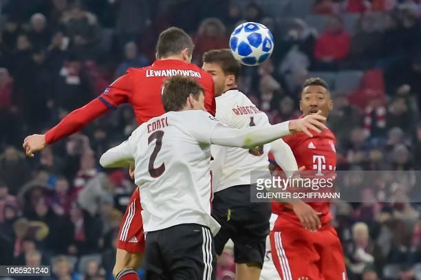 Bayern Munich's Polish forward Robert Lewandowski scores the 41 goal during the UEFA Champions League Group E football match Bayern Munich vs Benfica...