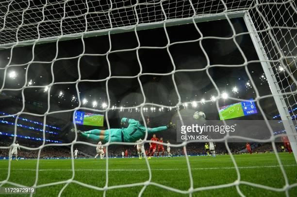 Bayern Munich's Polish forward Robert Lewandowski scores their second goal during the UEFA Champions League Group B football match between Tottenham...