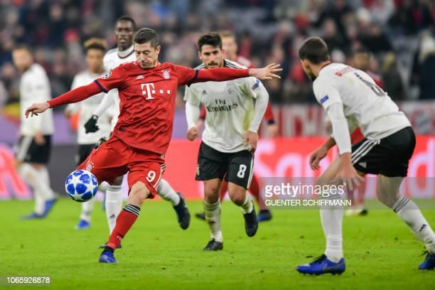 Bayern Munich's Polish forward Robert Lewandowski shoots during the UEFA Champions League Group E football match Bayern Munich vs Benfica Lisbon in...