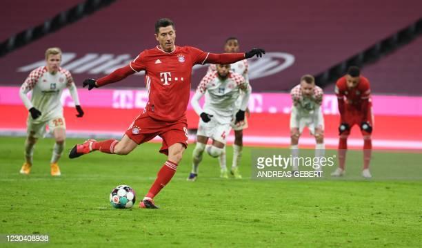 Bayern Munich's Polish forward Robert Lewandowski shoots to score the 4-2 during the German first division Bundesliga football match FC Bayern Munich...
