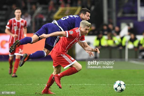 Bayern Munich's Polish forward Robert Lewandowski vies with Anderlecht's Serbian defender Uros Spajic during the UEFA Champions League Group B...
