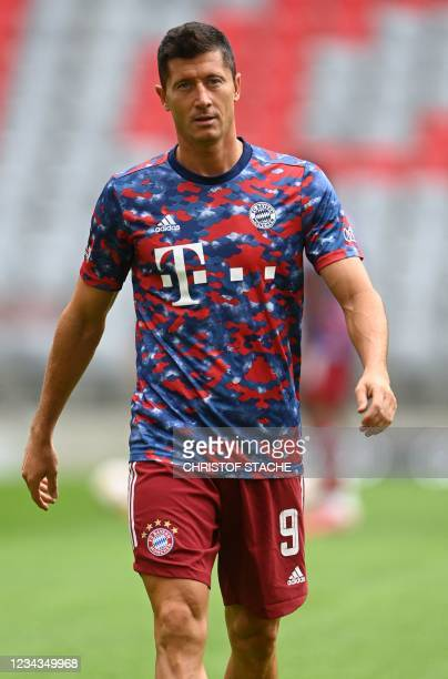 Bayern Munich's Polish forward Robert Lewandowski walks to the field for the warm up prior the Audi Summer Tour 2021 football match FC Bayern Munich...