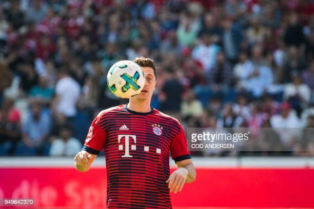 Bayern Munich's Polish forward Robert Lewandowski warms up prior to the German first division Bundesliga football match between Hannover 96 vs Bayern...
