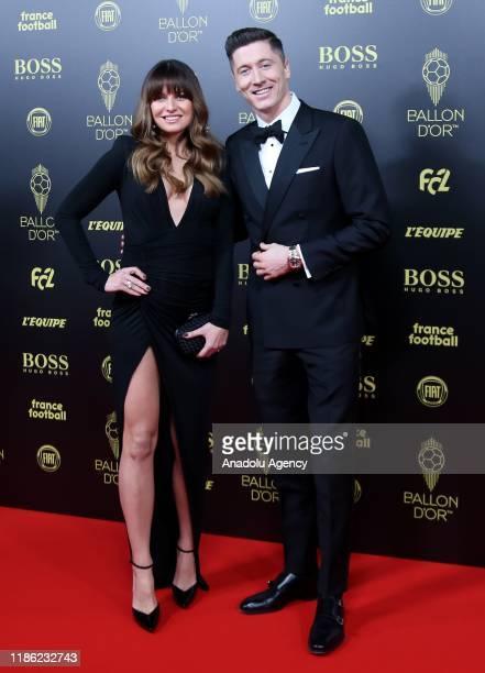 Bayern Munichs Polish soccer player Robert Lewandowski and his athlete wife Anna Lewandowska arrive to attend for the Ballon d'Or ceremony at Theatre...