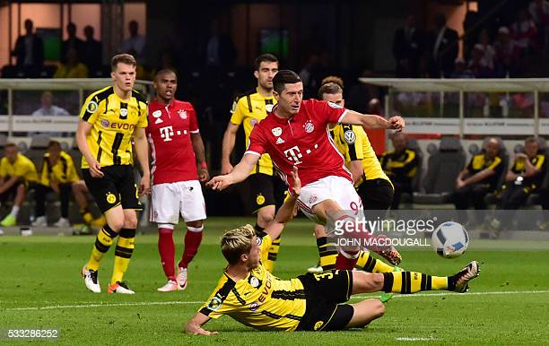 Bayern Munich's Polish striker Robert Lewandowski and Dortmund's defender Erik Durm vie for the ball during the German Cup final football match...
