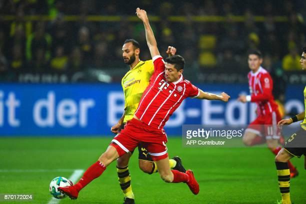 Bayern Munich´s Polish striker Robert Lewandowski and Dortmund's Turkish defender Oemer Toprak vie for the ball during the German First division...
