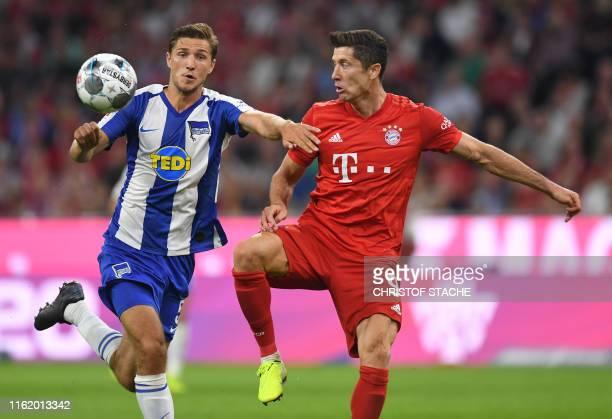 Bayern Munich's Polish striker Robert Lewandowski and Hertha Berlin's German defender Niklas Stark vie for the ball during the German First division...