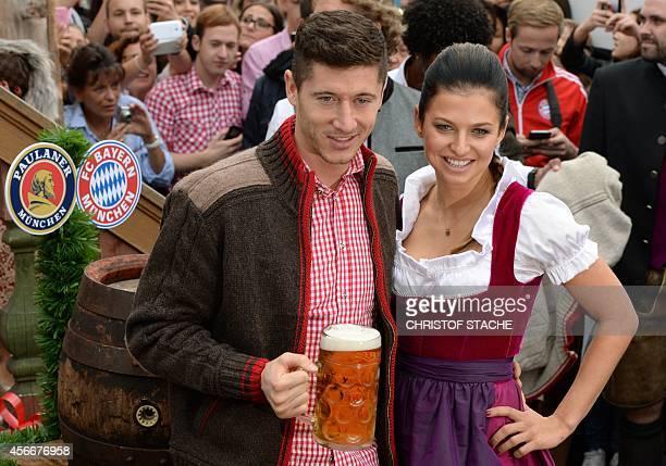 Bayern Munich's Polish striker Robert Lewandowski and his wife Anna Stachurska arrive for the traditional visit of German first division football...