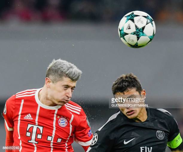 Bayern Munich's Polish striker Robert Lewandowski and Paris SaintGermain's Brazilian defender Thiago Silva head for the ball during the UEFA...