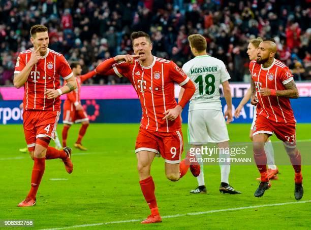 Bayern Munich's Polish striker Robert Lewandowski celebrates after scoring a goal during the German first division Bundesliga football match Bayern...