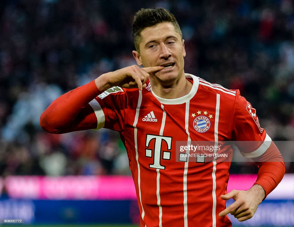 Bayern Munich's Polish striker Robert Lewandowski celebrates after scoring a goal during the German first division Bundesliga football match Bayern Munich vs Werder Bremen in Munich, southern Germany, on January 21, 2018. / AFP PHOTO / Guenter