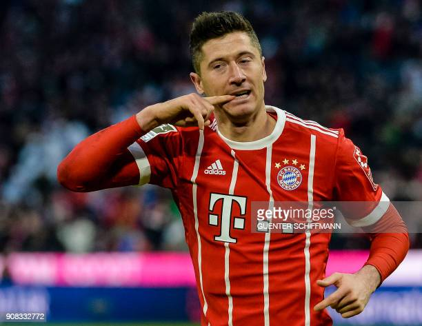Bayern Munich's Polish striker Robert Lewandowski celebrates after scoring a goal during the German first division Bundesliga football match Bayern...
